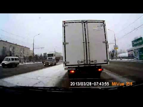 Oblivious Truck Driver Pushes Car Down Street in Russia