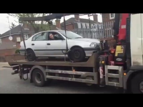 If your car is getting towed, don't try this!