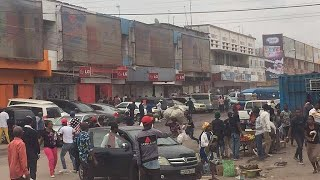 Nearly a dozen men armed with knives and batons burst into the largest market in Democratic Republic of Congo's capital...