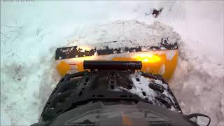 7. Can-Am Outlander 650 Plowing snow
