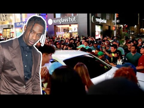 Travis Scott Fans Flood The Street And Surround The Rapper's Car In Times Square