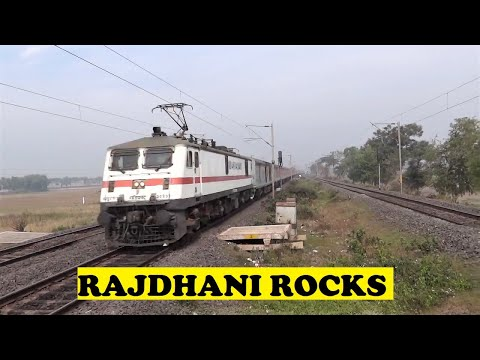 Howrah Rajdhani - Closely behind Sealdah Rajdhani, India's 1st Rajdhani and 2nd fastest Rajdhani, front panto WAP7 21 coach 12302 Howrah Rajdhani comes whining through the mor...