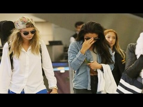 Return - Selena Gomez Slammed with Justin Bieber Questions on her Return to LA. Selena Gomez returned to Los Angeles with international supermodel Cara Delevingne, at LAX. Selena showed off her abs,...