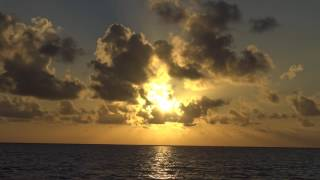 Watching the Sunrise from the San Pedro shore in Belize. 4K Video accompanied by some nice chillout music from AKmusique ...