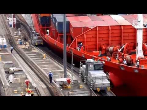 ship - Panama Canal tow train or mule being crushed as it was pulling a container ship on April 03, 2014. Filmed with a Sony Nex camera from the balcony. All worker...