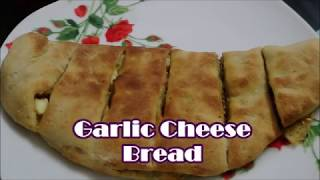 Easy cheesy garlic bread, step by step instruction  to make soft cheesy and yummy garlic bread. For more recipes log on to http://reshuskitchen.blogspot.com/