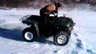 9. 2010 yamaha grizzly 700 eps doing a donut on ice