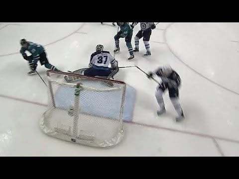 Video: Sharks' Couture slides the puck around Hellebuyck shorthanded