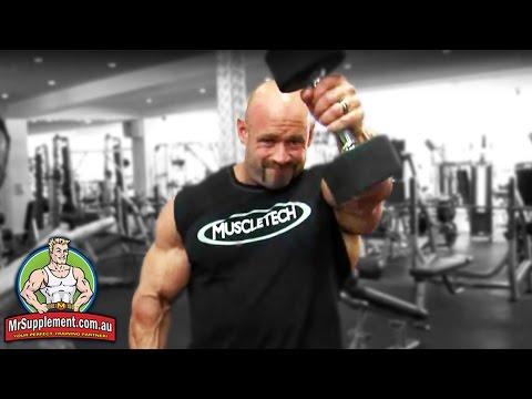 front delt - http://www.mrsupplement.com.au - Arnold Classic Winner Branch Warren demonstrates the Dumbbell Front Raise exercise technique. Branch's tips: use the mind-mu...