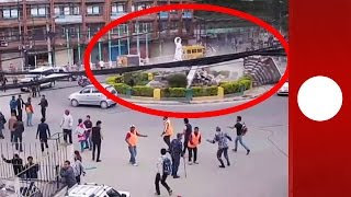 CCTV footage released on April 30 shows the impact of the 7.9-magnitude earthquake on a busy roundabout in the south of...