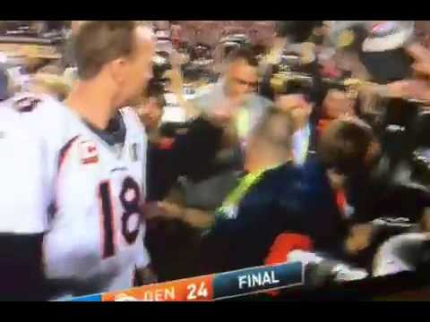 That's My Boy! Papa John Gives Peyton Manning A Kiss