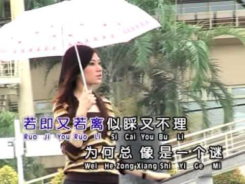 黄泳胜唱首情歌给谁听/你像一个谜/雨中的女郎 - DomaVideo.Ru