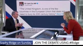 Watch This British Politician Deny Posting a Controversial Tweet with the Tweet on a Screen Behind Him