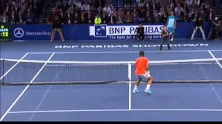 An exhibition game between Roger Federer and Grigor Dimitrov took a turn when a young boy was invited onto the court. Wearing...
