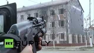 Video ID: 20141204-031 W/S Armed security forces fire on school building M/S Armed security forces fire on school building C/U ...