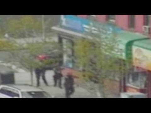 shoot out - An armed bandit fires away at cops as he comes storming out of a pharmacy he had just robbed with an accomplice. The Post Got It Covered: Twitter: http://twi...
