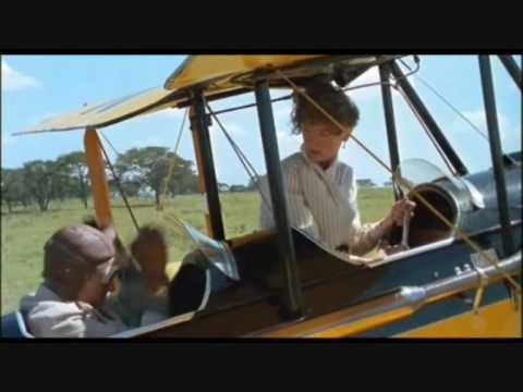 Tekst piosenki John Barry - Flight Over Africa po polsku