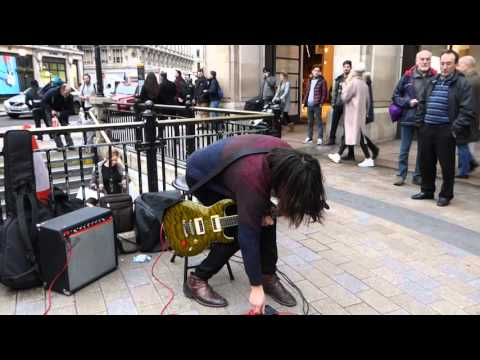 Amazing Street guitar performer playing Sultans of swing