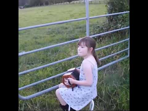 A little girl and a herd of cows.
