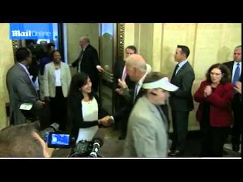 Hugs from Biden as government employees return to work