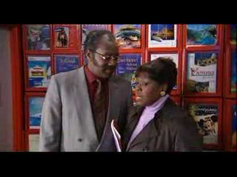 Donovan and Mrs Johnson in the travel agent