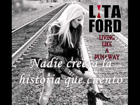 Tekst piosenki Lita Ford - Asylum po polsku