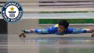 Video Farthest distance limbo skating under bars - Guinness World Records MP3, 3GP, MP4, WEBM, AVI, FLV September 2017