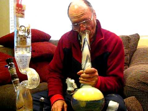 Grandpa takes a really big bong hit.