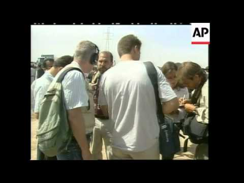 GNS Thousands of bodies found in mass grave, Chalabi visits scene