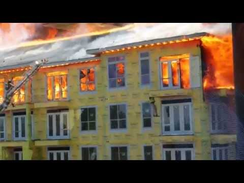Building Burns While Construction Worker Jumps Floor to Floor