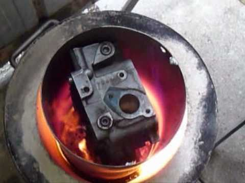 Cylinder head melted in mega crusible.wmv