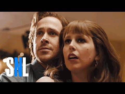 Ryan Gosling and Vanessa Bayer Play a Pair of Obsessed Santa Fans at a Holiday Party in  Santa