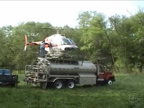 helipad - Provine Helicopters gypsy moth eradication project in Clay Co. North Carolina. Bell 206 IIIB and nurse truck.