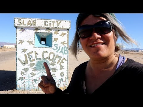 Tribe In Slab City ...Pig Climbs Salvation Mountain