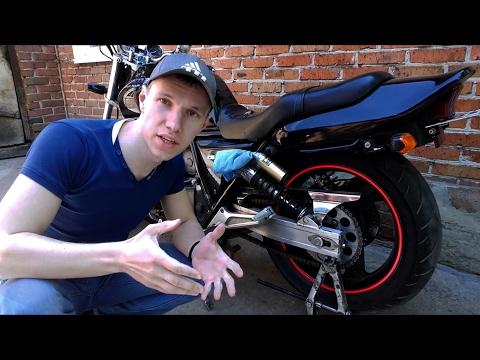 Регулировка цепи на мотоцикле хонда снимок