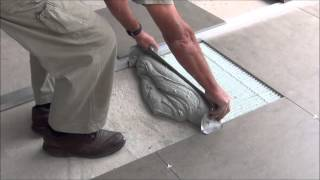 how to lay large format tiles without using a self-levelling compound