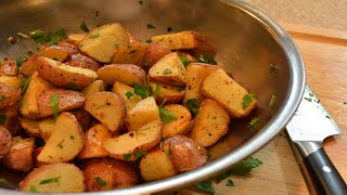 Roasted Potatoes with Garlic and Rosemary Super simple Recipe for a delicious and quick side dish that pairs with almost anything!