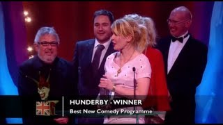 Hunderby has won the audience over and deserved its win in the Best New Comedy Programme category!The concept for the Awards was originally devised and produced by British TV legend, Michael Hurll to promote homegrown comedy talent. The original show was presented by Michael Parkinson and winners included VICTORIA WOOD as Best Live Stand-up, PAULINE QUIRKE as Best TV Comedy Newcomer, and DROP THE DEAD DONKEY as the Best New TV Comedy. Other winners included RUSS ABBOTT, CLIVE JAMES & ROWAN ATKINSON.http://www.britishcomedyawards.com/https://twitter.com/comedyawardshttp://www.facebook.com/pages/British-Comedy-Awards/160295097348405