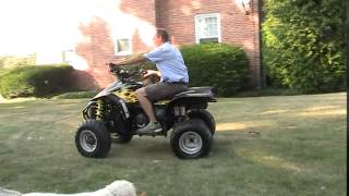 4. 2005 Polaris Scrambler 500 H.O. On Demand 4x4 Automatic Reverse