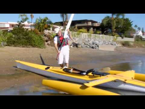 2010 TRIAK Preview:  Preview of the 2010 TRIAK trimaran sailing kayak. This video shows some of the new features in action including: new stepped mast with furling loose-footed full-batten main, spinnaker snuffer, daggerboard, larger rudder, new bow and awesome new amas (floats) with waver piercing bows. Enjoy and thanks for watching. If you have questions please email us at info@triaksprots.com.