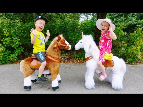 Gaby and Alex Ride on Toy Horses