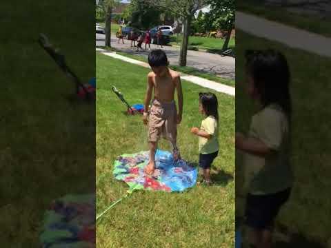Sprinkler fun with Cael & Carlisle