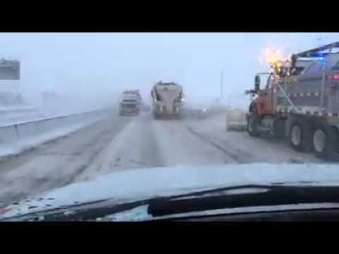 WATCH: Driver Nearly Crushed By Snowplows