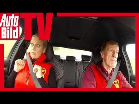 German Rallye legend Walter Roehrl drives a german tv-presenter around a track. Her expressions are hillarious.