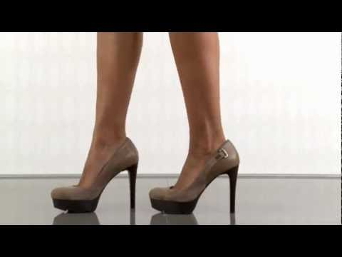 multiple heels and shoes - To purchase please visit: http://www.heels.com/womens-shoes/ivins-brown-multi-suede.html This Guess style is the perfect partner to your little black dress. ...