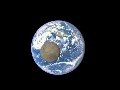 epic video of sunlit 'dark side' of moon crossing over earth discove