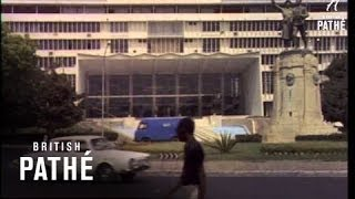 Dakar, Senegal. Exterior of Universitie of Dakar. Two native Senegal guards in red berets with rifles stand outside. Building with ...
