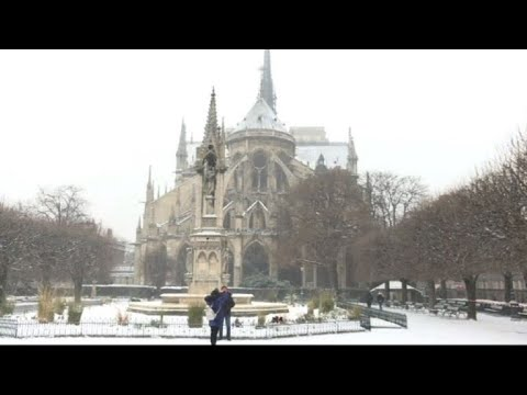Fresh snowfall in Paris covers Notre-Dame Cathedral
