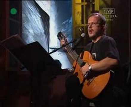 Tekst piosenki Jacek Kaczmarski - Czerwcowy wicher przy kominku po polsku