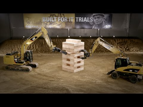 World's largest Jenga game, played with CAT equipment.